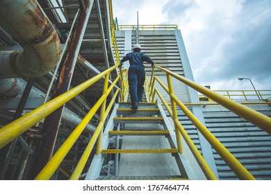 Male walking up the stairway inspection visual in factory
