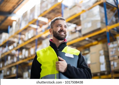 Male warehouse worker with clipboard.