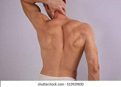 Male Waxing. Muscular male back, torso, chest and armpit hair removal.