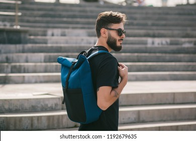 Male wearing sunglasses model backpackers travel summer traveler holidays in the city.