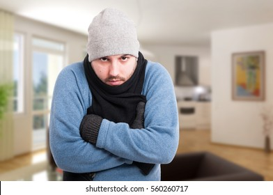 Male in winter clothes inside the house looking sick as health problem concept with copyspace