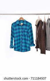 Male winter jacket with shirt, on hanger