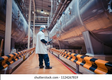 Male work inspection process milk powder cellar at the with horizontal  stainless steel tanks factory