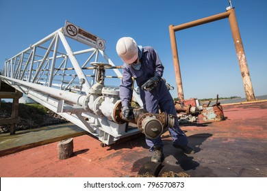 Male worker inspection and measurement thickness pipeline oil and gas at jetty