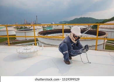 Male worker are for inspection  ultrasonic thickness roof plate top of storage tank
