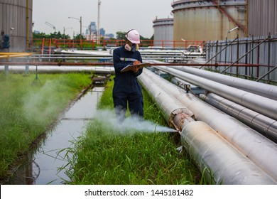 Male worker inspection visual pipeline oil and gas corrosion rust through socket tube steam gas leak pipeline at insulation.