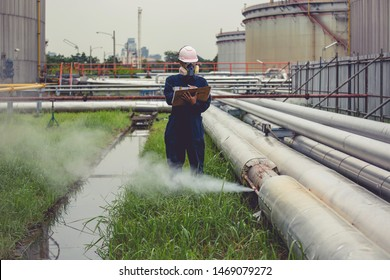 Male worker inspection visual pipeline oil and gas corrosion rust through socket tube steam gas leak pipeline