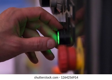 Male Worker operating a machine in a factory by pushing a button control panels for electrical equipment