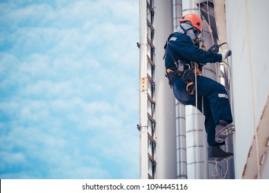 Male worker rope access  inspection of thickness shell plate storage tank industry