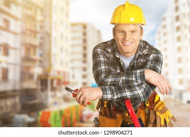 Male worker with tool belt isolated on