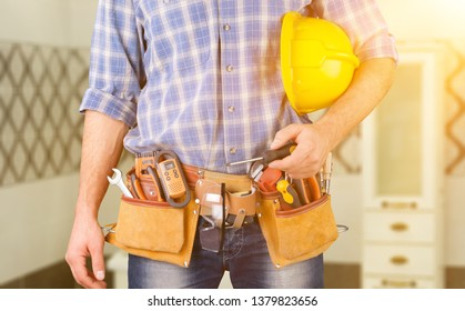 Male worker with tool belt isolated on white  background