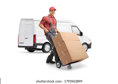 Male worker in a uniform pushing a hand truck loaded with boxes in front of a white van isolated on white background