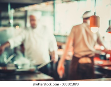 male workers cooking in Turkish restaurant