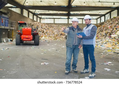 male workers planning in recycling center