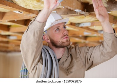 male working on ceiling