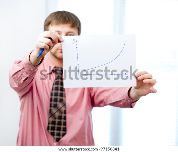 male writing something on paper with marker