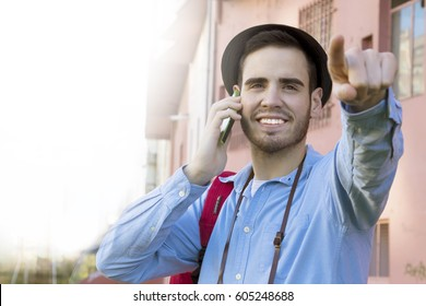 male young modern in the street speaking by phone mobile