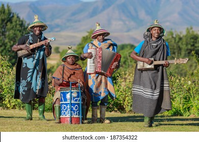 MALEALEA, LESOTHO - APRIL 12: Unidentified group of local musicians , dressed with traditional Basotho blankets and hats on April 12 2014 in Malealea, Lesotho.