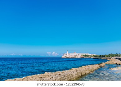 Malecon and el Morro Castle fortress and lighthouse in Havana bay on a clear Autumn day, Cuba.