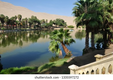 Malecon of Huacachina lagoon in the Ica desert.