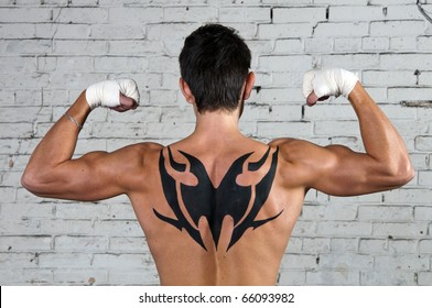 Male's back with tribal tattoo