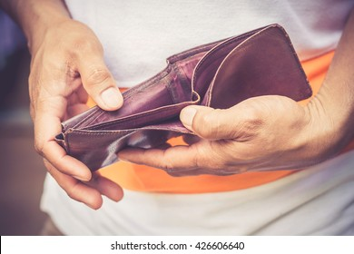 Male's hand holding an empty wallet