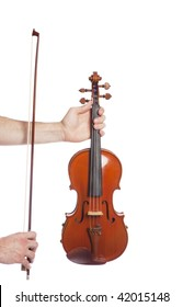 Males hands holding violin and bow on isolated white