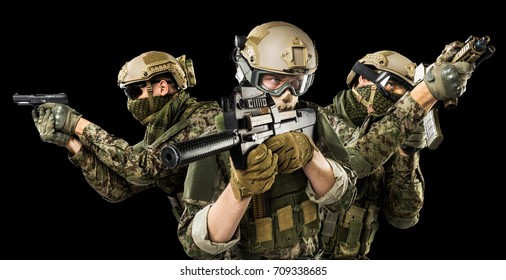 Males in uniform of Tactical Units of Police with rifle. Shot in studio. Isolated with clipping path on black background