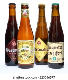 MALESICE, CZECH REPUBLIC - OCTOBER 11, 2014: Bottles of belgian beer Westmalle, Trappiste Rochefort and Tripel Karmeliet.