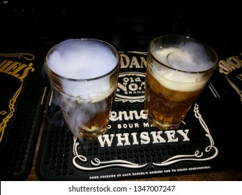 Malevich/Ukraine - March 11 2019:Whiskey drink in glass at night party
