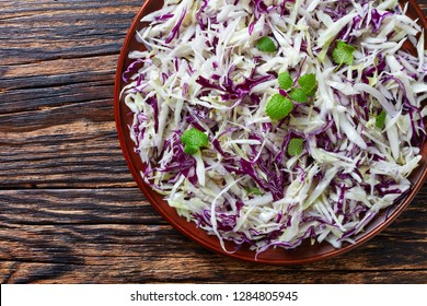 Malfouf Salad, Lebanese Cabbage Slaw, a simple cabbage salad made with lemon juice, olive oil, garlic, and mint, flatlay, view from above, close-up, macro