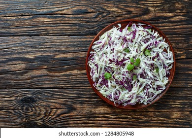 Malfouf Salad, Lebanese Cabbage Slaw, a simple cabbage salad made with lemon juice, olive oil, garlic, and mint, flatlay, view from above, copy space