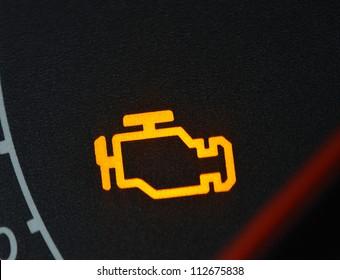 Malfunction or check engine car symbol, dash board close up