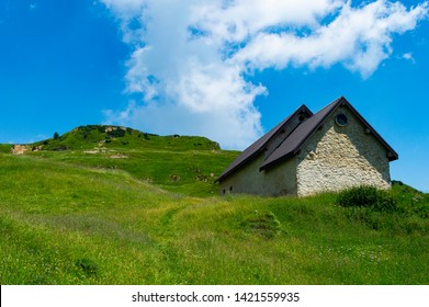 malga on the green meadows of asiago with a beautiful sky and blue, a symptom of tranquility and pasture