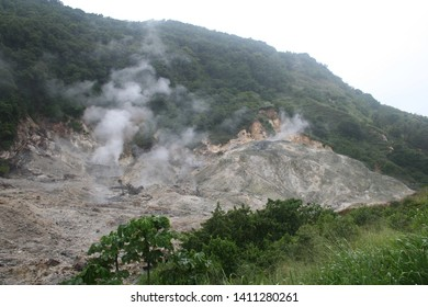 Malgretoute - Sulfur Springs - St. Lucia - August 19, 2013. Stean arising from St. Lucia Sulfur Springs located near the village of Soufriere.