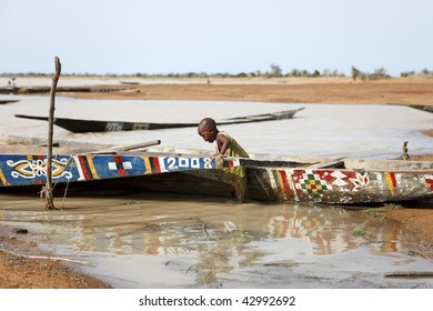MALI - AUGUST 18: Children playing in pinnace, the bank of river Niger is also used by children to play uploaded to pinnaces, August 18, 2009 in Djenne, Mali