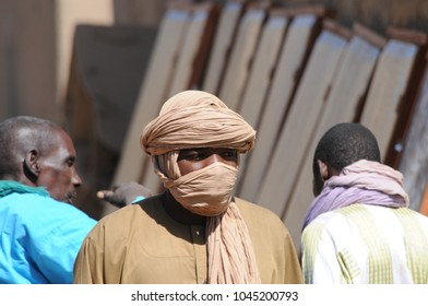 Djennè, Mali - December, 28, 2014: Adult african man at the colorful market in Djenne