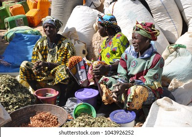 Djennè, Mali - December, 28, 2014: African woman at daily market of Djenne