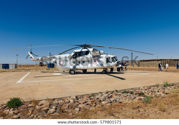 Mali, Goundam - January 30, 2017: UN helicopter unloading at Goundam helipad in dangerous Timbuktu region at United Nation peacekeeping mission in Western Africa.