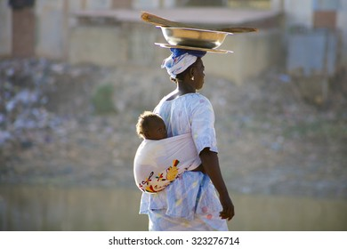 MALI, MOPTI, DECEMBER 28: Unidentified Woman carrying a baby in her back in the streets of Mopti. 2010