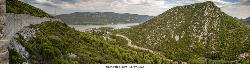 Mali Ston to Ston panorama. Medieval town Mali Ston in Dubrovnik area at the one end of the world known Ston walls. Second in world the longest defense wall with fortress Koruna.