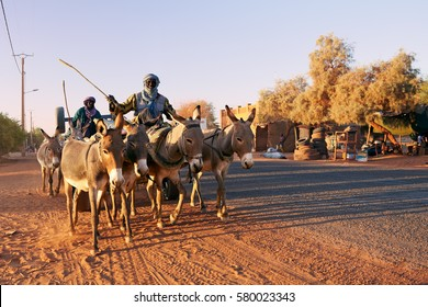 Mali, Timbuktu - February 02, 2017:  A view to the evening traffic on the main street in currently most dangerous in West Africa Timbuktu town, controlled by United Nations and Malian army forces.