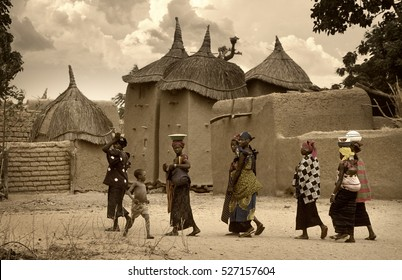 Mali, West Africa - January 25, 1992: Dogon village and typical mud buildings with  barns for cereals and Peul Fulani populations, portrait of child