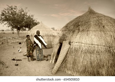 Mali, West Africa - January 25, 1992: Peul village and typical mud buildings with barns for cereals, Fulani popolations