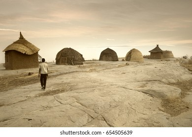 Mali, West Africa - Peul village and typical mud buildings with barns for cereals, Fulani popolations