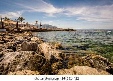 Malia, Crete, Greece - May 18, 2019. People resting on the sunny day on the beach