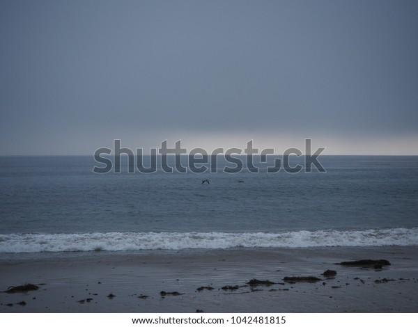 MALIBU BEACH, CALIFORNIA - JAN 05, 2018: Feeling lonely with the view of Malibu sea and grey sky