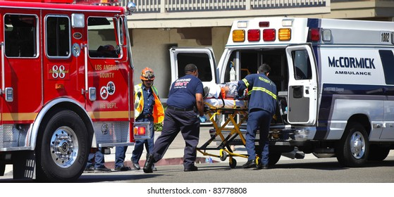 MALIBU, CALIFORNIA/USA - AUGUST 27, 2011: Unidentified firefighters help the victim of car accident on Pacific Coast Highway on August 27, 2011 in Malibu, California