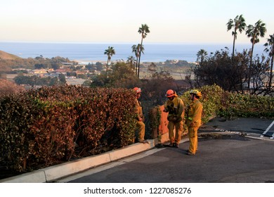 MALIBU - NOV 11: Firefighters are observing the scene in Malibu during the wildfire in Malibu, CA on November 11, 2018