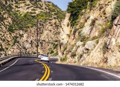 Malibu, USA. Circa September 2013. Cars drive along a winding California highway.